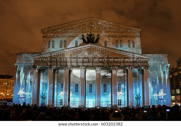 MOSCOW, RUSSIA - September 26, 2016 Ballet Dance Under Moon Light at Facade of Bolshoi Theater. 3D video mapping remake of Swan Lake ballet during International Festival Circle of Light in Moscow.