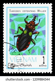 MOSCOW, RUSSIA - SEPTEMBER 26, 2018: A stamp printed in Vietnam shows Assasin Bug (Tiarodes ostentans), Insects serie, circa 1982