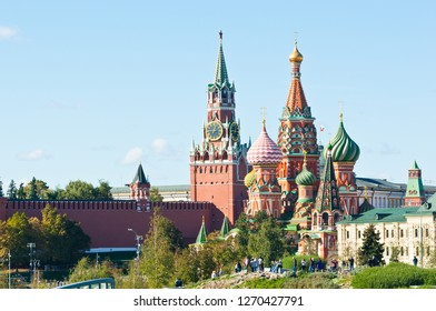 "MOSCOW, RUSSIA - SEPTEMBER 26, 2018: Spasskaya Tower of Moscow Kremlin and Cathedral of Vasily the Blessed (Saint Basil's Cathedral) on Red Square in sunny day.  View from park ""Zaryadye"""