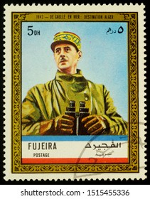 """Moscow, Russia - September 26, 2019: A stamp printed in Fujeira shows General de Gaulle in uniform with binoculars at sea in 1943: destination Algiers, series """"Charles de Gaulle"""", circa 1972"""