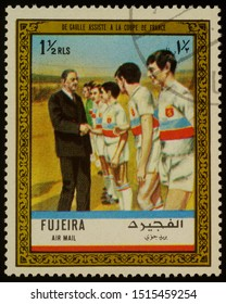 """Moscow, Russia - September 26, 2019: A stamp printed in Fujeira shows Charles De Gaulle assisting at the French Cup, series """"Charles de Gaulle"""", circa 1972"""