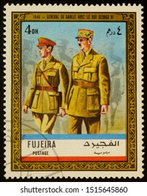 """Moscow, Russia - September 26, 2019: A stamp printed in Fujeira shows General Charles de Gaulle and King George VI in uniform in 1940, series """"Charles de Gaulle"""", circa 1972"""