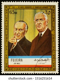 """Moscow, Russia - September 26, 2019: A stamp printed in Fujeira shows President de Gaulle meets Chancellor Adenauer in 1963, series """"Charles de Gaulle"""", circa 1972"""