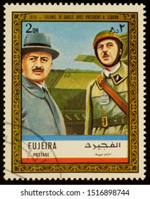 """Moscow, Russia - September 26, 2019: A stamp printed in Fujeira shows Colonel De Gaulle with President Albert Lebrun in 1939, series """"Charles de Gaulle"""", circa 1972"""