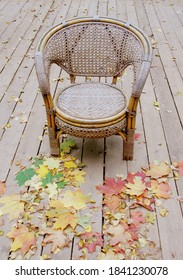 Moscow, Russia, September 27, 2016, outdoor wicker chair in the Park, autumn foliage on a wooden platform, many chairs are on top of each other, folded chairs.