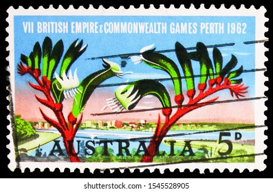 MOSCOW, RUSSIA - SEPTEMBER 27, 2019: Postage stamp printed in Australia shows View of Perth, kangaroo paw - Anigozanthos manglesii, 5 d - Australian penny, Commonwealth Games, Perth serie, circa 1968