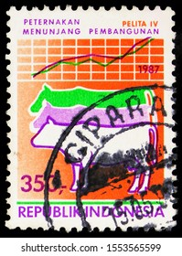 MOSCOW, RUSSIA - SEPTEMBER 27, 2019: Postage stamp printed in Indonesia shows Cows, Agriculture, Five Year Development Plan serie, circa 1987