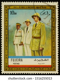 """Moscow, Russia - September 28, 2019: A stamp printed in Fujeira shows General Charles de Gaulle and Rene Pleven in Brazzaville in 1944, series """"Charles de Gaulle"""", circa 1972"""