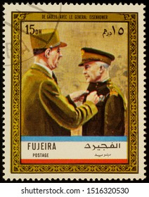 """Moscow, Russia - September 28, 2019: A stamp printed in Fujeira shows General Charles de Gaulle and General Eisenhower in uniform, series """"Charles de Gaulle"""", circa 1972"""