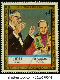 """Moscow, Russia - September 28, 2019: A stamp printed in Fujeira shows Pope Paul VI receives Charles de Gaulle in 1967, series """"Charles de Gaulle"""", circa 1972"""