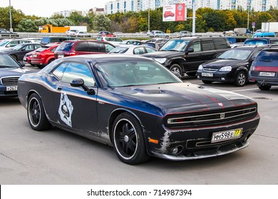 MOSCOW, RUSSIA - SEPTEMBER 29, 2012: Sports car Dodge Challenger Hennessey HPE650 in the city street.