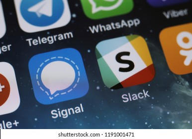 Moscow, Russia - September, 29 2018 The logos of the Signal and Slack applications are displayed on the screen of an Apple iPhone