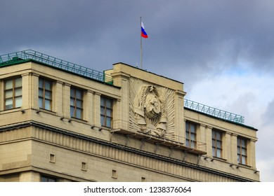 Moscow, Russia - September 30, 2018: Fragment roof of State Duma of Russian Federation closeup with waving Russian flag on a cloudy sky background at autumn day