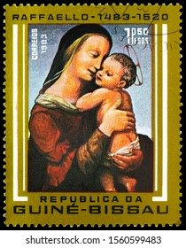 MOSCOW, RUSSIA - SEPTEMBER 30, 2019: Postage stamp printed in Guinea-Bissau shows Madonna and Child, 1.50 Guinea-Bissau peso, 500th Anniversary of the Birth Raffaello serie, circa 1983