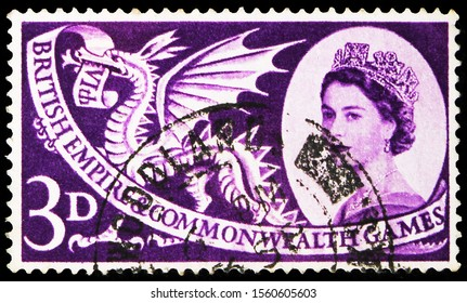 MOSCOW, RUSSIA - SEPTEMBER 30, 2019: Postage stamp printed in United Kingdom shows Welsh Dragon, 3 d - British penny (old), Commonwealth Games serie, circa 1958