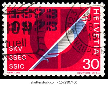MOSCOW, RUSSIA - SEPTEMBER 30, 2019: Postage stamp printed in Switzerland shows Quill pen & arrow signet, Swiss Society of Commerce serie, circa 1973
