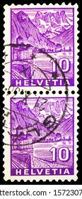 MOSCOW, RUSSIA - SEPTEMBER 30, 2019: Two postage stamps printed in Switzerland shows Chillon Castle and Dents du Midi, Landscapes serie, circa 1934