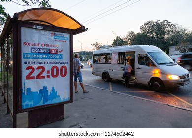 MOSCOW, RUSSIA - SEPTEMBER 7, 2018: People at a public transport stop. Poster for the election campaign of the mayor of Moscow which will held on September, 9