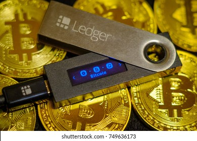 Moscow, Russia - September 8, 2017: Cold crypto wallet Ledger Nano S lying on golden bitcoin coins