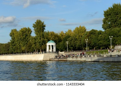 MOSCOW, RUSSIA SEPTEMBER 9, 2017: People rest on Pushkinskaya embankment of Gorky Park in Moscow.