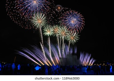 MOSCOW, RUSSIA - Spectacular colorful Japanese fireworks in shape of chrysanthemums, palm trees and comets during the Japanese Hanabi fireworks show at the closing ceremony of Circle of Light Festival