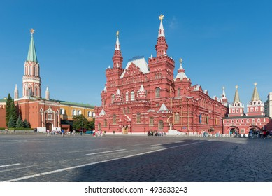 Moscow, Russia. The State Historical Museum in Moscow on the Red Square. The spires and towers of the Kremlin the rays of the rising sun.
