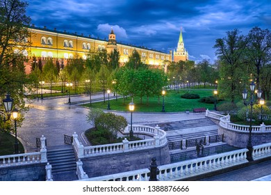 MOSCOW, RUSSIA - Upper Alexander Garden in the Early Spring Morning Twilight. View from Manezhnaya square on the illuminated  park along the fortified wall of Moscow Kremlin.