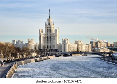 MOSCOW, RUSSIA - View from the new floating bridge of park Zaryadye on the frozen Moskva River (Moscow River and Stalinist high-rise building at Kotelnicheskaya embankment in the winter season.