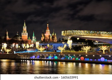 MOSCOW, RUSSIA - View from Raushskaya embankment of Moscow River on the Floating Bridge and Pier of Zaryadye Park? St. Basil's Cathedral, and Spasskaya (Savior) tower of the Kremlin in winter holidays