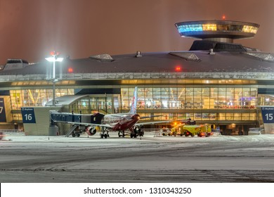 MOSCOW, RUSSIA. Vnukovo international airport, 12.26.2018 Airplanes are at the airport terminal Night blizzard