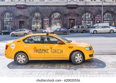 MOSCOW, RUSSIA-11 APRIL, 2017: Yandex taxi waiting for the client on Tverskaya street in Moscow