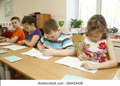MOSCOW, RUSSIA-APRIL 17, 2014: children play with toys and engage with the tutor in a kindergarten