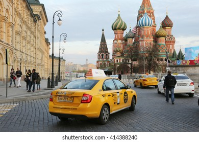 Moscow, Russia-April 2016: yellow taxis on the street in front of St. Basil's Cathedral
