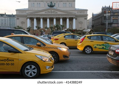Moscow, Russia-April 2016: yellow taxis on the street in front of the Bolshoi theatre