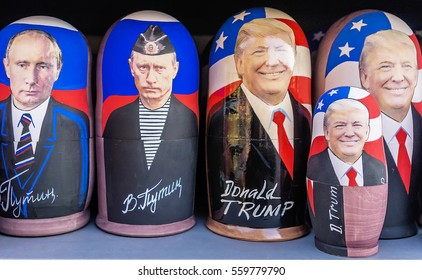 MOSCOW, RUSSIA-DECEMBER 17, 2017: Russian traditional toy - Matryoshka with a portrait of Putin and Trump. showcase souvenir kiosk