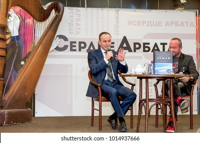 """Moscow, Russia-January 16, 2018: Space pilot, Hero of the Russian Federation Sergey Ryazansky. The presentation of the photobook """"Amazing Earth"""" in House of Books on the Arbat in Moscow."""