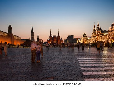 MOSCOW, RUSSIA-JULY 20, 2010. Dozens of travelers, walk through Red Square in Moscow and a chance to visit and photograph the cathedral St. Basil on sunset on July 20, 2010