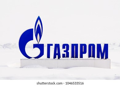 MOSCOW, RUSSIA-MARCH 11, 2018: GAZPROM logo on the background of snow. Gazprom is a Russian transnational energy corporation