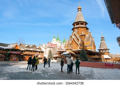 Moscow, Russia-March 23, 2018: Inner yard in Izmailovo Kremlin, the Church of St. Nicholas, the highest wooden temple of Russia on the right, locals and tourists go sightseeing.