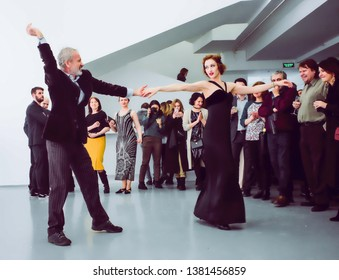 Moscow, Russia-March 5, 2019: Girl dancer invited a man to dance. Art Deco Broadway dancers at a party in the gallery
