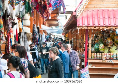 Moscow, Russia-May 07,2018: Daily market full all sorts of Russian souvenirs, crafts and antiques to buy in Izmailovo Kremlin, crowd of locals and tourists go shopping.