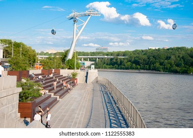 Moscow, Russia-May 24,2018: Luzhnetskaya embankment along Moscow River on May 24,2018, people sunbathing in Moscow, Russia.