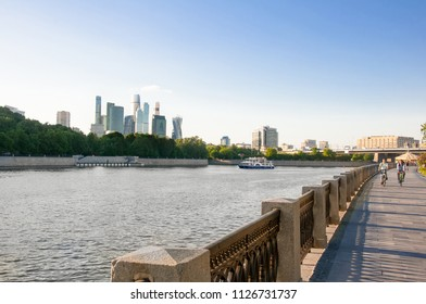 Moscow, Russia-May 24,2018: Luzhnetskaya embankment along Moscow River Moscow with the Moscow International Business Centre in the background, people on the street, Russia.