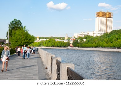 Moscow, Russia-May 24,2018: Modern Luzhnetskaya embankment along Moscow River on May 24,2018, people on the street Moscow, Russia.