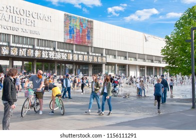 """Moscow, Russia-May 27, 2018: State Tretyakov Gallery on Krymsky Val with so called """"dry"""" fountains, crowd of people on street."""