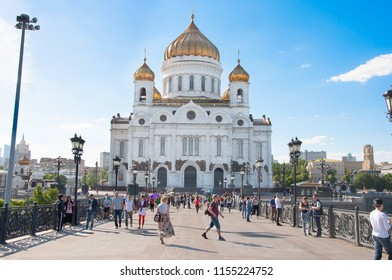 Moscow, Russia-May 27,2018: Cathedral of Christ the Saviour and Patriarshy Bridge full of people spanning Moskva River and Vodootvodny Canal.
