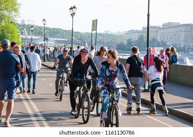 Moscow, Russia-May 27,2018: Gorky Central Park of Culture and Leisure full of locals, people ride bicycles on embankment along Moskva River.