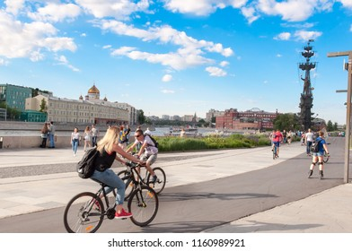 Moscow, Russia-May 27,2018: Krymskaya embankment full of locals and tourists in the vicinity of Museon Park and the Krymsky Bridge with Peter the first monument in the distance.
