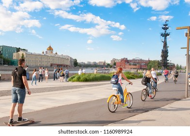 Moscow, Russia-May 27,2018: Krymskaya embankment full of locals and tourists in the vicinity of Museon Park and State Tretyakov Gallery on Krymsky Val with Peter the first monument in the distance.