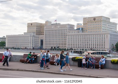 Moscow, Russia-May 27,2018: The Main Building of the Russian Defense Ministry on Frunze embankment seen from Gorky Central Park, people on the street.